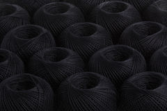 Background black yarn. Texture of colored yarn skeins royalty free stock photography