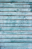 Background blue boards. Background blue old peeling boards are arranged vertically Stock Images