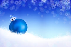 Background with blue christmas ball in the snow Stock Photo