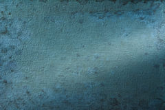 Background of a blue cloth highlighted by a spotlight. Royalty Free Stock Image