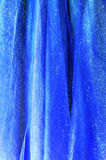 Background from blue delicate fabric Stock Photos