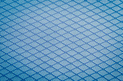 Background of blue fabric. Background of close focus on dark blue texture fabric of polyester fiber and nylon. It designed as crossing pattern of crosswise Royalty Free Stock Image