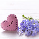 Background with  blue  flowers and  pink decorative heart Royalty Free Stock Photo
