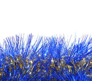 Background of blue and golden Christmas garland on white with place for your text Royalty Free Stock Photography