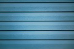 Background with blue metallic striped fragment of the facade of a building royalty free stock images
