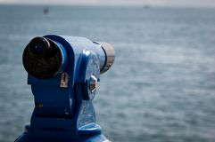 Background of a blue panoramic touristic telescope overlooking the sea stock image