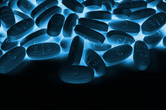 Background of blue pills Stock Photo