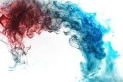 A background of blue and red wavy smoke of mystical appearance o. N a white ground. Bright abstract pattern of steam from vape royalty free stock photo