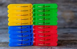 Background of blue, red, yellow and green linen clothespins stock photo