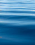 Background of blue rippled water stock photos