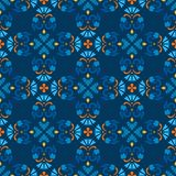 Background, blue, seamless pattern with blue flowers and orange branches. Royalty Free Stock Image