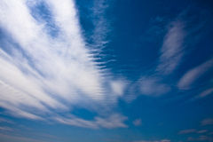 Background blue sky. Sky blue and white cloud streaks Stock Photography