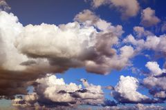 Background from a blue sky with clouds of different colors. royalty free stock photography