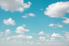 Background of blue sky and fluffy clouds vintage filter. Stock Photo