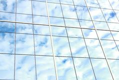 Background of blue sky reflect on glasses from  business buildin Royalty Free Stock Image