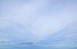Background of the blue sky and some soft white clouds.  Stock Photo