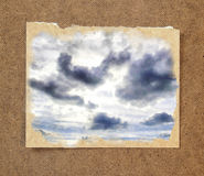 Background of blue sky and sun under dark clouds in the passepar. Tout Royalty Free Stock Images