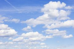 Background of Blue Sky with White Cumulus Clouds. Stock Photo