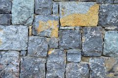 Fine cut blue stone wall. The background for the blue stone wall texture royalty free stock images