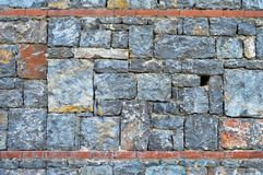 Fine cut blue stone wall. The background for the blue stone wall texture stock image