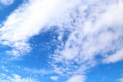 Background. Blue sunny sky with beautiful clouds. Stock Photography
