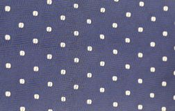 Background of blue tie with white speck. Texture Stock Images