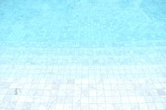 Blue tiled pool with clear cool rippling water. Background of a blue tiled pool with clear cool rippling water stock photos