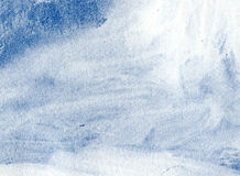 Background, blue and white. White watercolor wash on blue paper Royalty Free Stock Images
