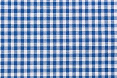 Blue and white checkered tablecloth. Background of blue and white checkered tablecloth Royalty Free Stock Photography