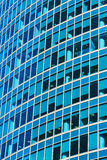 Background of blue windows of a modern office building.  Tint bl. Ue Royalty Free Stock Photos