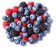 Background from Blueberry. Raspberry and blueberry fruits on white Stock Images