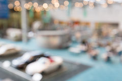 Background blur of car in showroom. abstract interior office wit Stock Photos