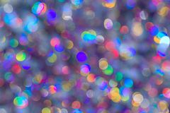 Background of blur colorful texture bokeh for Festival and New year. Game of color. Abstract Christmas purple backdrop. royalty free stock photography
