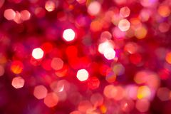 Background blur texture bokeh, violet, yellow, pink, six sides, round. Defocused abstract red christmas background. royalty free illustration