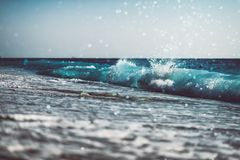 background of blurred beach and sea waves with bokeh Royalty Free Stock Images