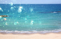 Background of blurred beach and sea waves with bokeh lights Stock Photo