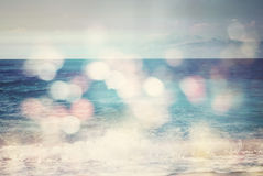 Background of blurred beach and sea waves with bokeh lights royalty free stock image
