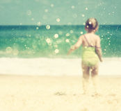 Background of blurred beach and sea waves with bokeh lights, vintage filter. Royalty Free Stock Photos