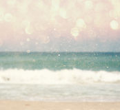 Background of blurred beach and sea waves with bokeh lights, vintage filter. Stock Photo