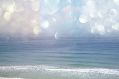 Background of blurred beach and sea waves with bokeh lights, vintage filter. Stock Photography