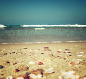 Background of blurred beach and sea waves, vintage filter. Royalty Free Stock Image