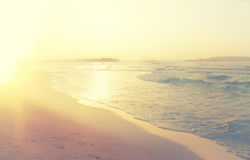 Background of blurred beach and sea waves, vintage filter. Royalty Free Stock Photos