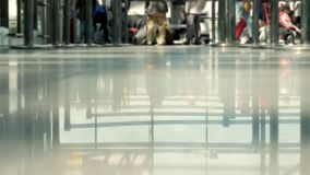 Background: Blurred people walk at the airport. Zones for queue to register foreground stock footage