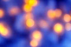 Background of blurry blue-blue lights of the Christmas-tree garland on the dark. Copy space stock images