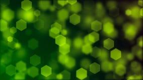 Background of blurry green hexagonal bokeh. Abstract Background with blurry hexagonal bokeh Stock Photo