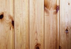 Background boards pine. Background, tree, spruce, pine, paneling, bitches, harvesting, construction material, patterned, striped, green,brown, warm Stock Image