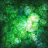 Background with bokeh effect. Green vector background with bokeh effect, circles Royalty Free Stock Image