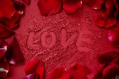 Background bokeh with text love. Copy space for text. The concept of romance and love. Valentine`s Day. Shiny texture background. Festive background. Red shiny stock photos