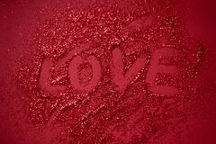 Background bokeh with text love. Copy space for text. The concept of romance and love. Valentine`s Day. Shiny texture background. Festive background. Red shiny royalty free stock photo
