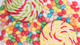 Background with bonbons and lolipops Stock Images